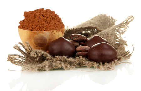 Composition of chocolate sweets and cocoa, isolated on white photo