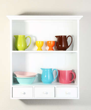 Kitchen utensils on beautiful white shelves photo