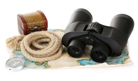 Black modern binoculars with map of adventure isolated on white photo
