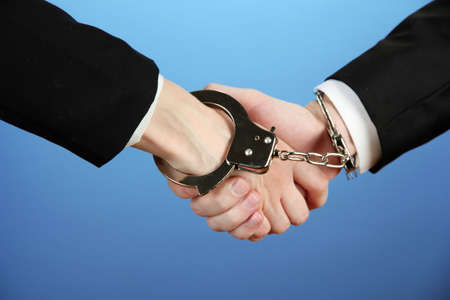 Man and woman hands and breaking handcuffs on color background Stock Photo - 19804436