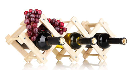 bordeau: Bottles of wine placed on wooden stand isolated on white