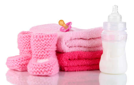 Bottle for milk with towels and nipple isolated on white Stock Photo - 19803454