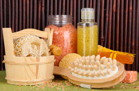 cleanser: Cleanser, brush and cosmetics for shower on table on bamboo background