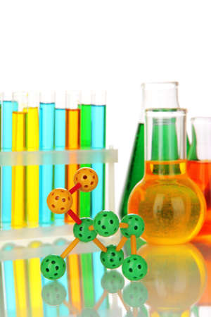Molecule model and test tubes with colorful liquids isolated on white photo