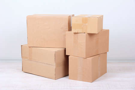 stockpiling: Different cardboard boxes in room Stock Photo