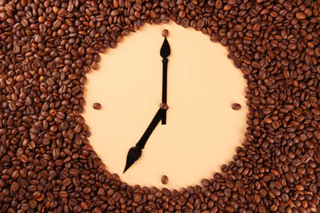 Wall clock of coffee beans, close up photo