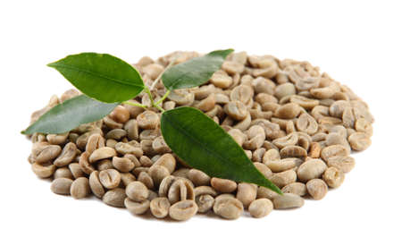 Green coffee beans and leaves isolated on white photo
