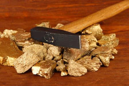 hummer: Golden nuggets with hummer on wooden background