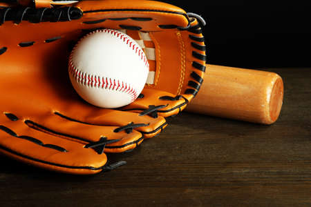 Baseball glove, bat and ball on dark background Stock Photo - 19770228