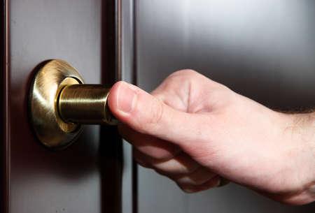 opens: Someone opens door close-up