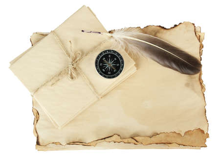 Old paper, letters and compass isolated on white photo
