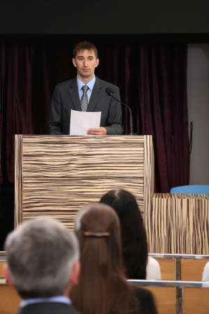Business man is making a speech at conference room photo