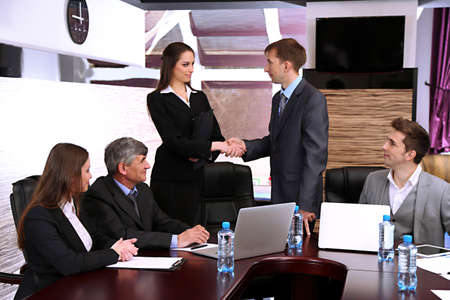 concluded: Business people working in conference room