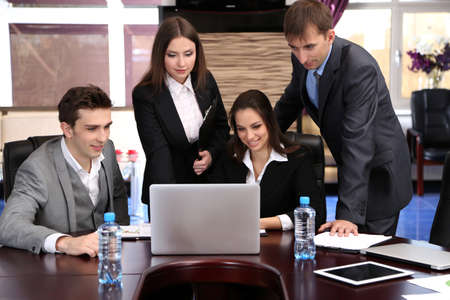 technology agreement: Business people working in conference room