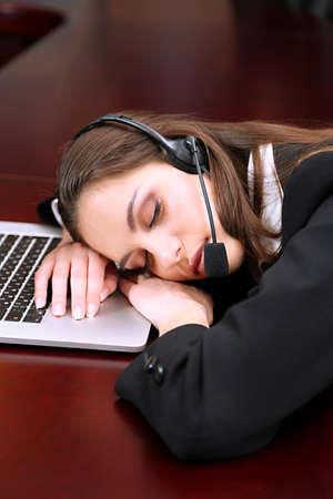 Asleep call center operator at work photo