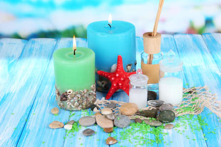 Sea spa composition on wooden table on blue natural background photo