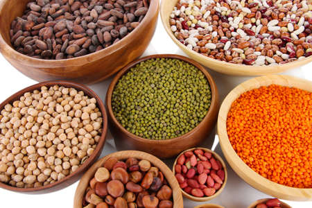 Different kinds of beans in bowls close-up photo