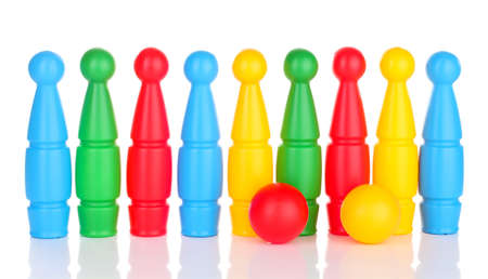 Colorful plastic skittles of toy bowling isolated on white photo