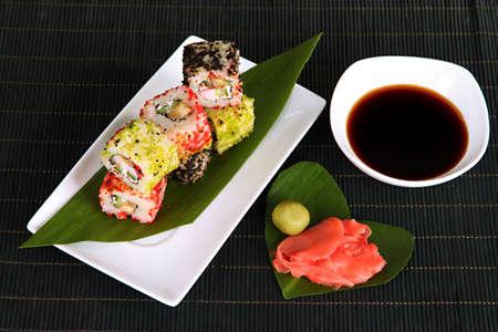 Tasty Maki sushi - Roll on plate on mat photo