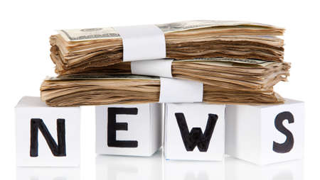 White paper cubes labeled News with money isolated on white