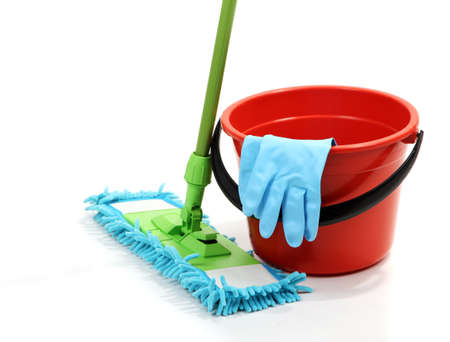 Mop, plastic bucket and rubber gloves, isolated on white photo
