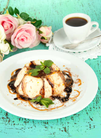 Panna Cotta with chocolate  and caramel sauces, on color wooden background photo