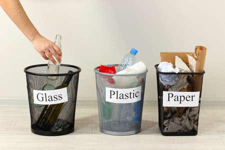Three buckets of assorted debris on room background photo