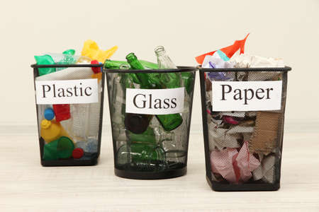 Buckets for waste sorting on room background photo