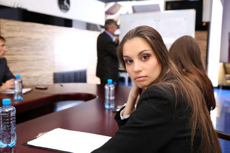 Portrait of young businesswoman in business training with her colleagues photo