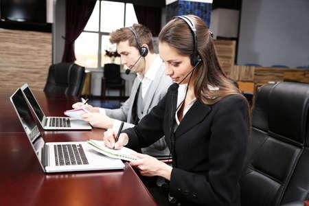 Call center operators at work Stock Photo - 20278524