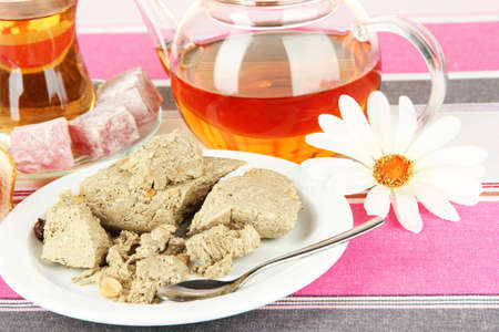 confect: Tasty halva with tea on table close-up Stock Photo