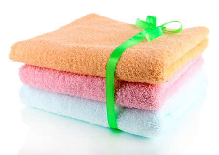 orange washcloth: Towels tied with ribbon isolated on white
