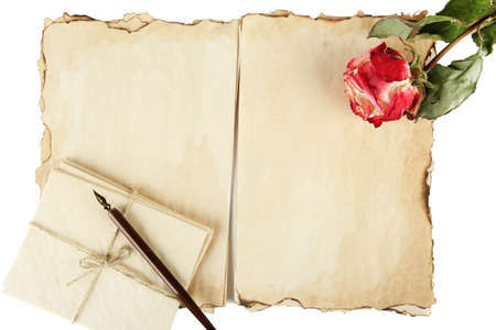 Old paper, letters and rose isolated on white photo