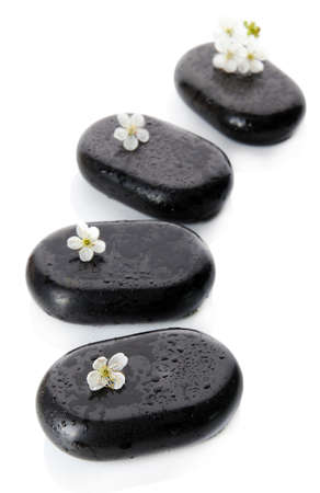 Spa stones and white flowers isolated on white photo