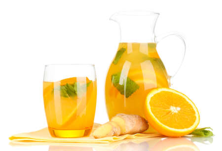 Orange lemonade in pitcher and glass isolated on white photo