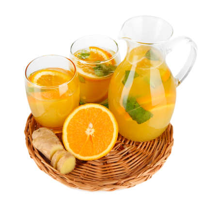 Orange lemonade in pitcher and glasses isolated on white photo