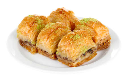 baklava: Sweet baklava on plate isolated on white