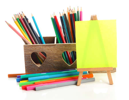Different pencils in wooden crate and easel, isolated on white Stock Photo - 19988738