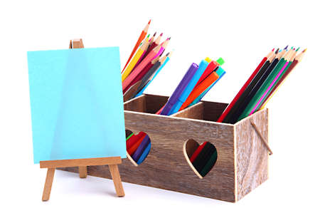 Different pencils in wooden crate and easel, isolated on white Stock Photo - 19988693