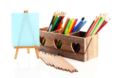 Different pencils in wooden crate and easel, isolated on white Stock Photo - 19988729