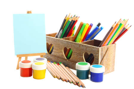 Different pencils in wooden crate, paints and easel, isolated on white Stock Photo - 19988691