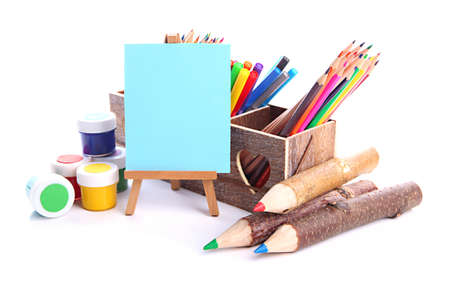 Different pencils in wooden crate, paints and easel, isolated on white Stock Photo - 19988706