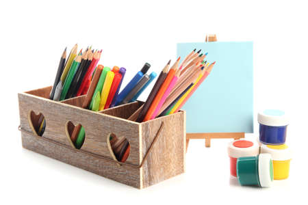 Different pencils in wooden crate, paints and easel, isolated on white Stock Photo - 19988709