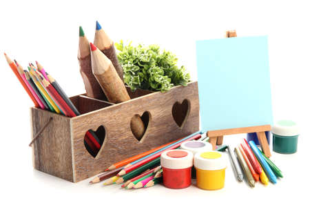 Different pencils in wooden crate, paints and easel, isolated on white Stock Photo - 19988670