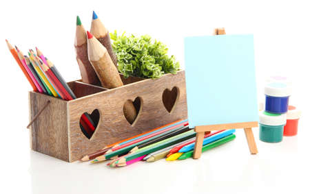 Different pencils in wooden crate, paints and easel, isolated on white Stock Photo - 19988713