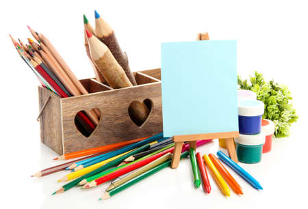 Different pencils in wooden crate, paints and easel, isolated on white Stock Photo - 19988688