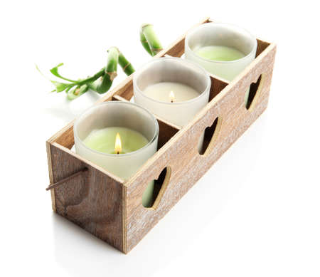 Wooden candlestick with candles and bamboo, isolated on white photo
