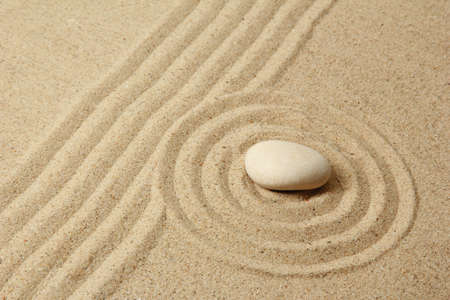 Zen garden with raked sand and round stone close up Stock Photo - 20012683
