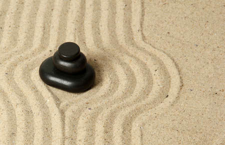 Zen garden with raked sand and round stones close up Stock Photo - 20012451