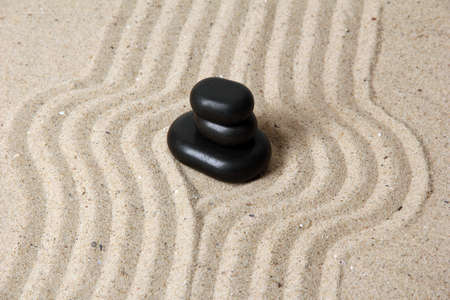 Zen garden with raked sand and round stones close up Stock Photo - 20012676